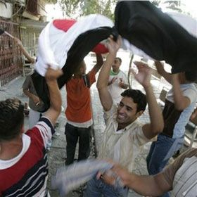 Fans celebrate Iraq`s victory over Saudi Arabia after the final match at the 2007 AFC Asian Cup soccer tournament