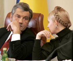 Юлія Тимошенко і Віктор Ющенко під час засідання Кабміну. Київ, 26 грудня