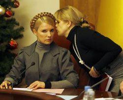 Юлія Тимошенко і її прес-секретар Марина Сорока під час засідання Кабінету Міністрів. Київ, 9 січня