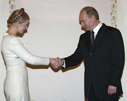 Юлия Тимошенко и Владимир Путин. Фото Reuters