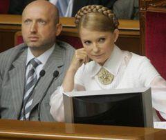 Юлія Тимошенко і Олександр Турчинов під час відкриття третьої сесії парламенту в залі засідань ВР. Київ, 2 вересня