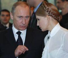 Володимир Путін і Юлія Тимошенко розмовляють на засіданні Ради голів урядів країн-учасниць СНД у Кишиневі. 14 листопада