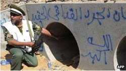 Omran al-Oweib said his men came under fire after they dragged Col Gaddafi from a drainage pipe