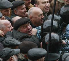 Participants of the protest action against cancellation of benefits for Chernobyl cleanup veterans breaking through the human barrier near the VR. Kyiv, November 1