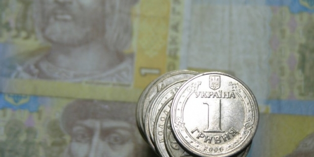 в 2014 году курс гривни снизился примерно на 11%