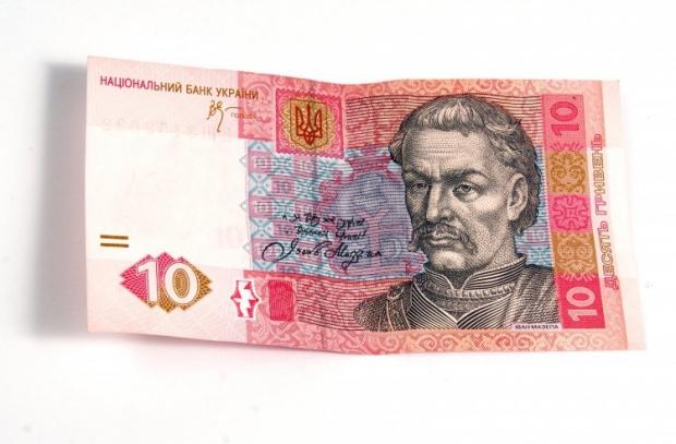 Котировки гривни по отношению к доллару к 12:00 повысились