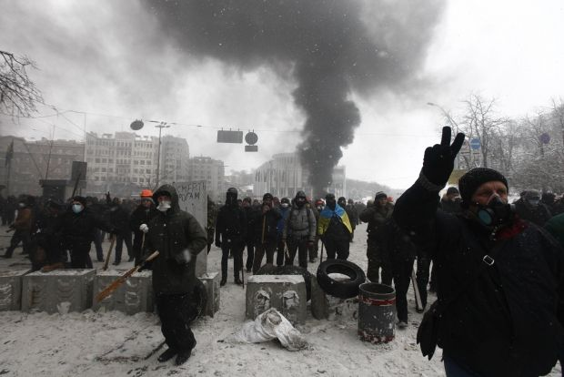 Clashes with law-enforcement officers  / Reuters