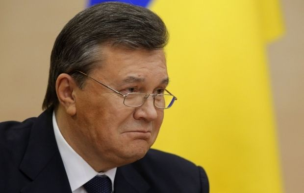 http://images.unian.net/photos/2014_02/1393599137-8918-yanukovich.jpg