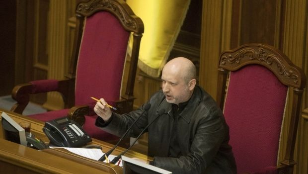 Turchynov signs law on ensuring rights and freedoms of citizens in occupied territory/ REUTERS