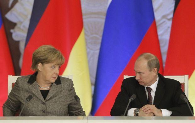Ангела Меркель і Володимир Путін / REUTERS