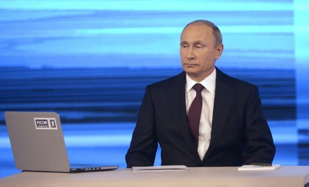 "Putin recognizes that ""green persons"" in Crimea were Russian soldiers / REUTERS"