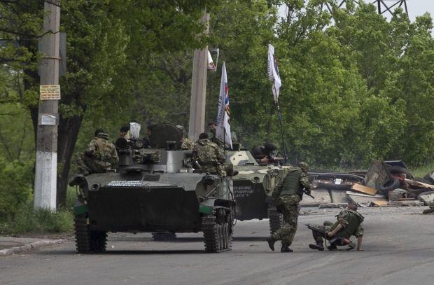 Днем среди террористов были замечены чеченские боевики/ REUTERS