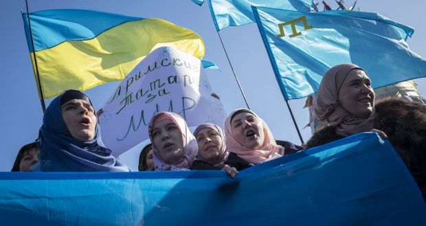 Crimean Tatar activists were interrogated and threatened with criminal cases on made-up charges / REUTERS