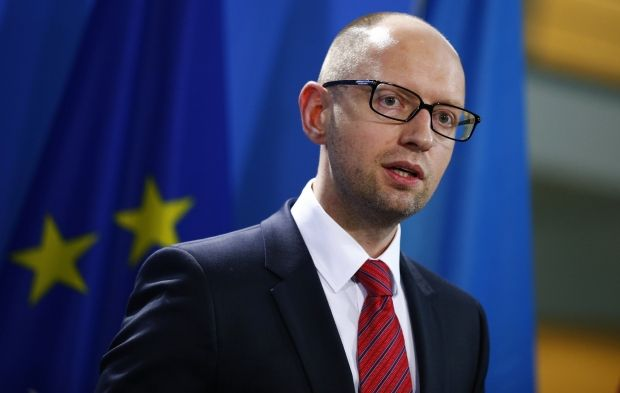 Yatsenyuk: if Russia stops supporting of terrorists, situation in east of Ukraine to be solved in one-two weeks/REUTERS