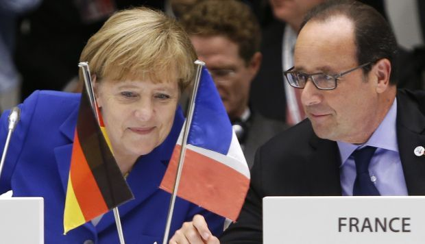 German Chancellor Angela Merkel and French President Francois Hollande / REUTERS