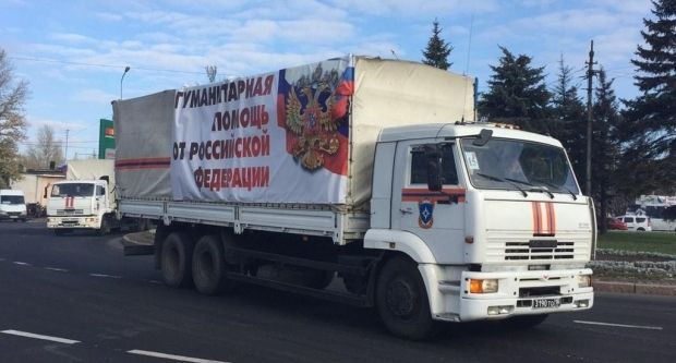 Moscow claims its truck convoys are carrying humanitarian aid, but Russia has not allowed Ukrainian customs officials to check them / Photo by Christopher Miller