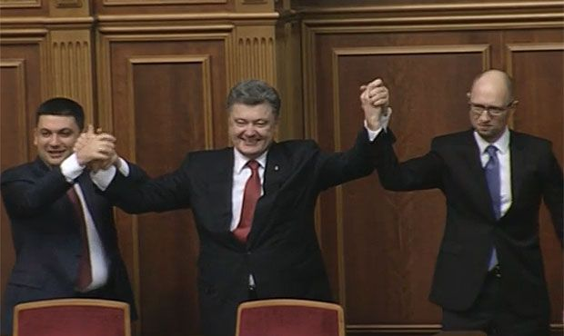 Arseniy Yatseniuk (right) was repointed as Ukraine's prime minister on Thursday.