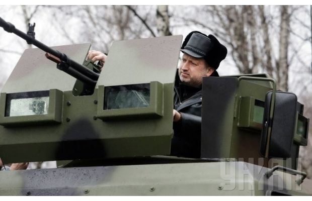 Turchynov is testing a military vehicle / Photo from UNIAN