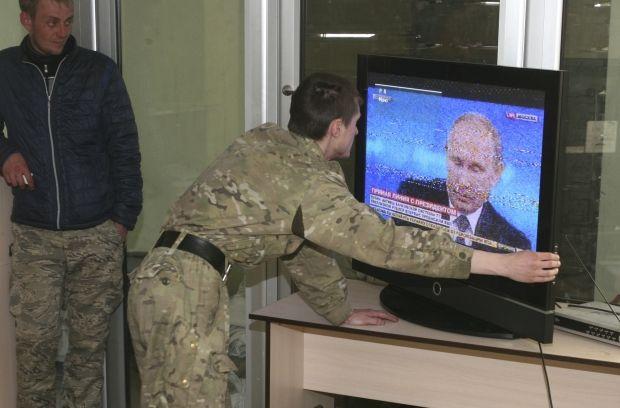 боевики путин пропаганда / Reuters