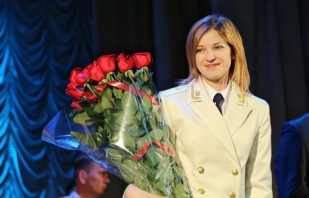 Crimean Prosecutor Natalya Poklonskaya who once earned her place in Internet history as a meme is wearing a ceremonial white jacket with general's shoulder straps / Photo from Crimean de facto head's press sevice