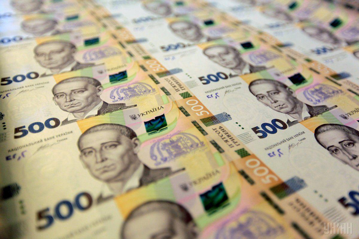 НБУ опустил официальный курс гривни к доллару