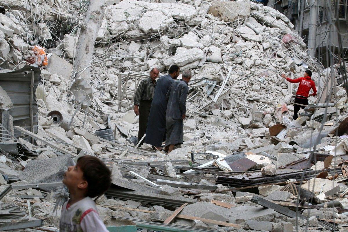 Последствия бомбардировки Алеппо / REUTERS