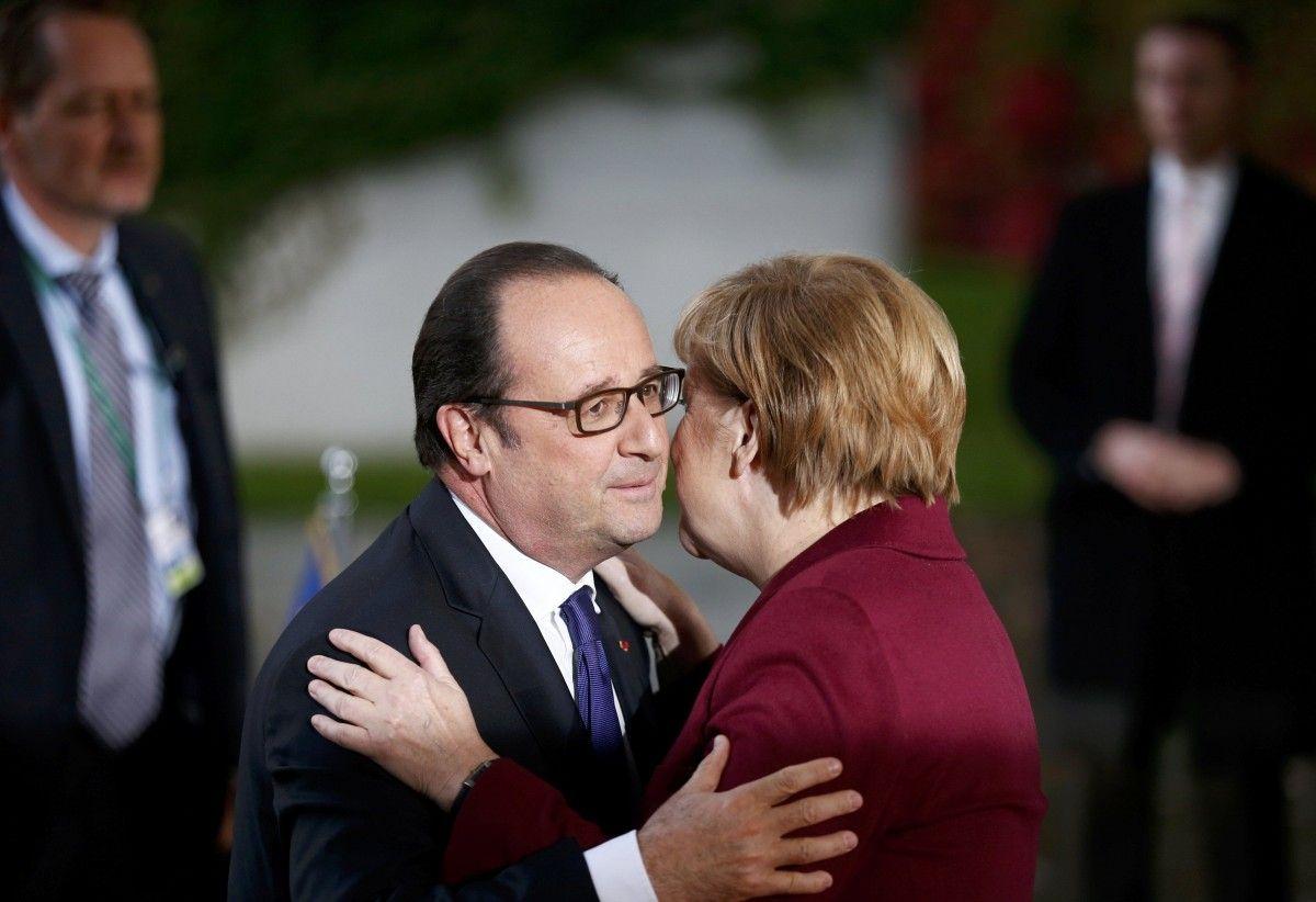 Франсуа Олланд и Ангела Меркель / REUTERS