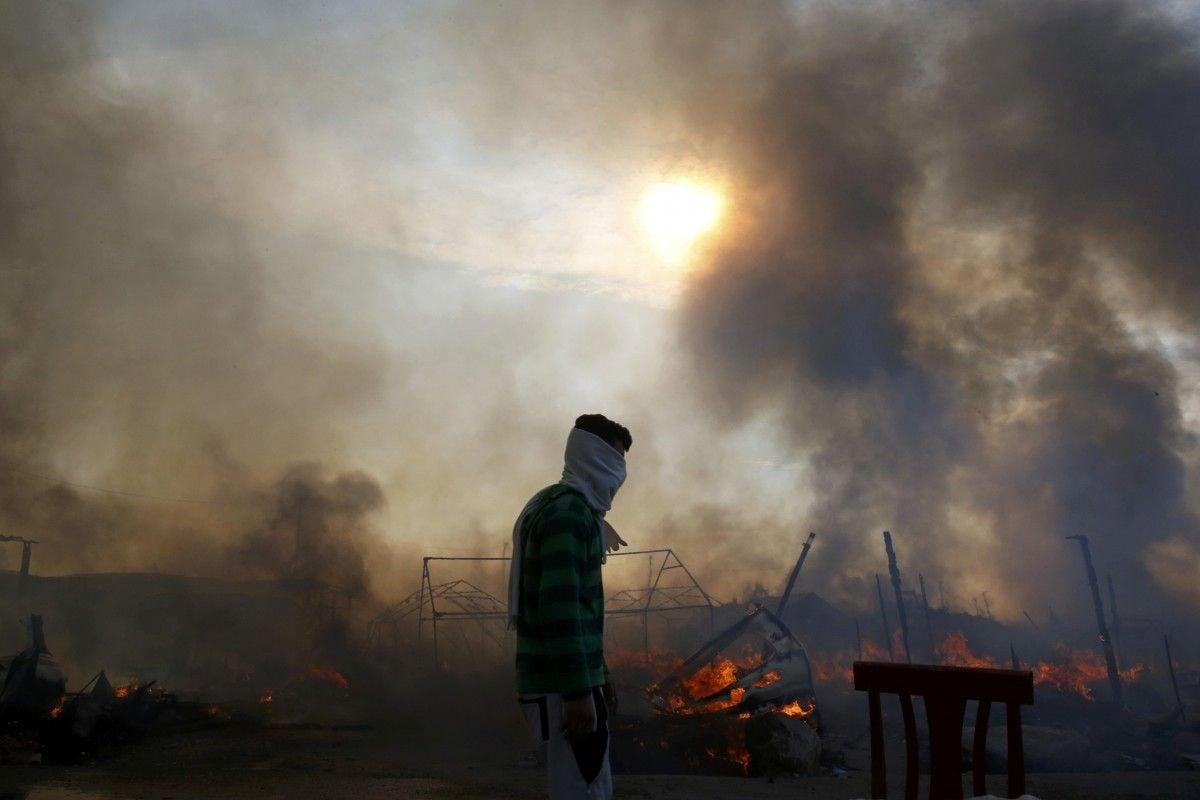 Мигранты в Кале / REUTERS