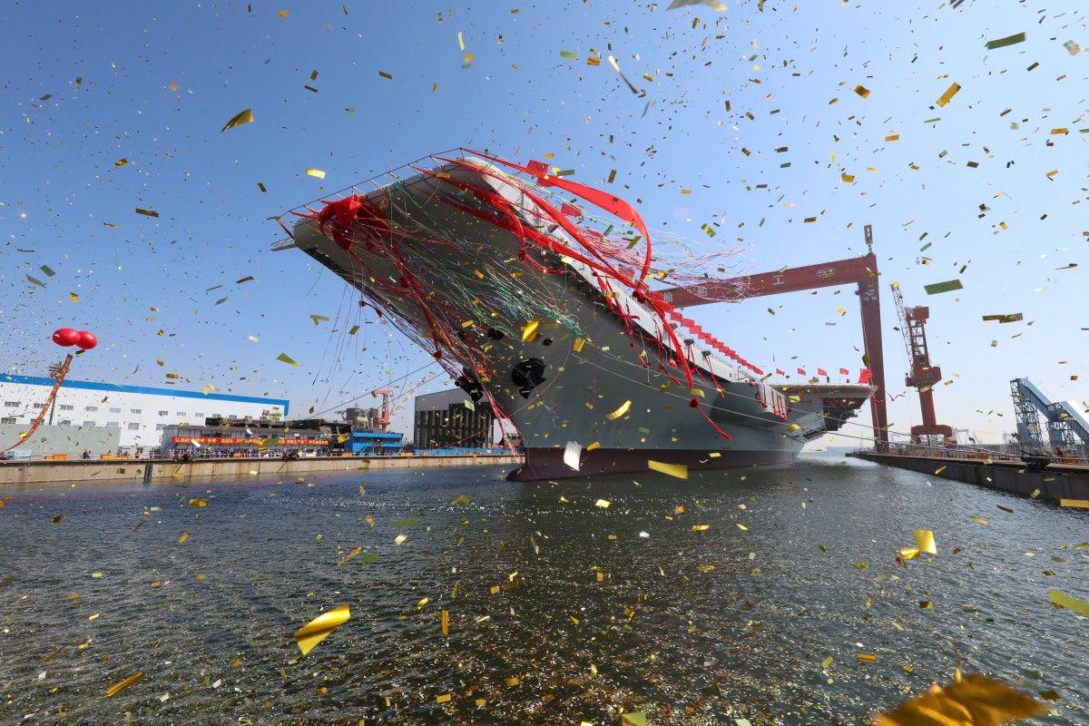 КНР  спустил наводу свой 1-ый  авианосец