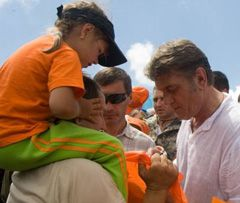 Victor Yushchenko giving autographs to participants of climbing on Goverla Mountain. July 18