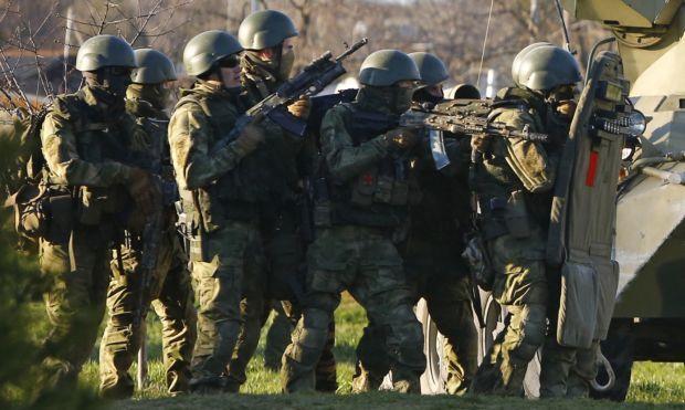 Путин признал, что войска РФ находились в Крыму до аннексии / REUTERS