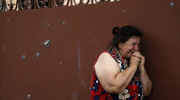 Terrorists fire at residential districts in Slaviansk. There are injured people among peaceful residents/ REUTERS