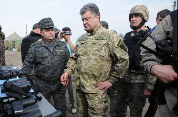 Poroshenko signs law on social protection of families of perished participants of ATO/Photo UNIAN