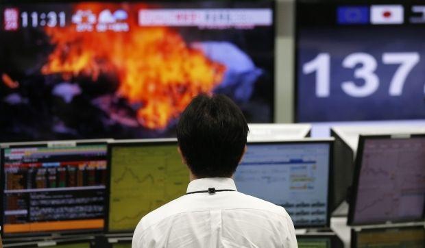 После сообщения о отставке Госсекретаря США Тиллерсона на Уолл-Стрит упали акции / фото REUTERS