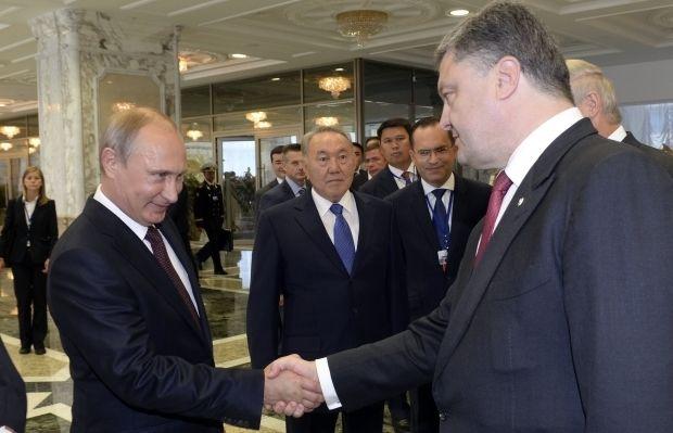 Володимир Путін і Петро Порошенко / REUTERS