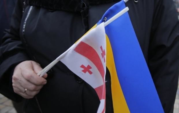 Грузинские флаги, украинские флаги – знак единства братских народов, которые попали в беду / фото УНИАН