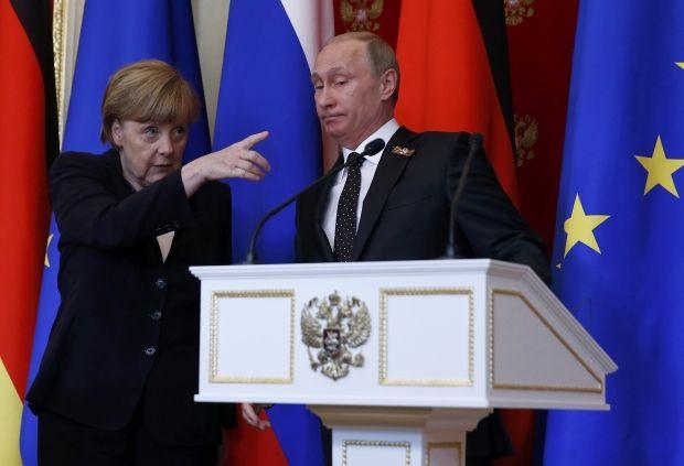 Ангела Меркель и Владимир Путин / REUTERS
