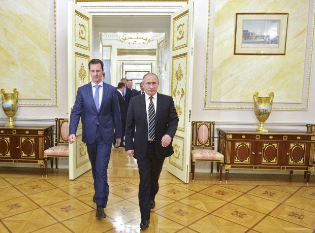 Башар Асад и Владимир Путин / REUTERS