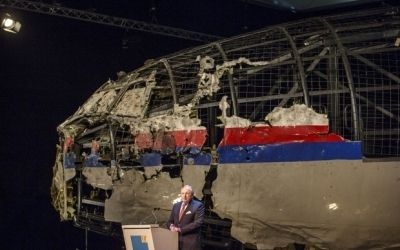 MH17. Tattered flight title=
