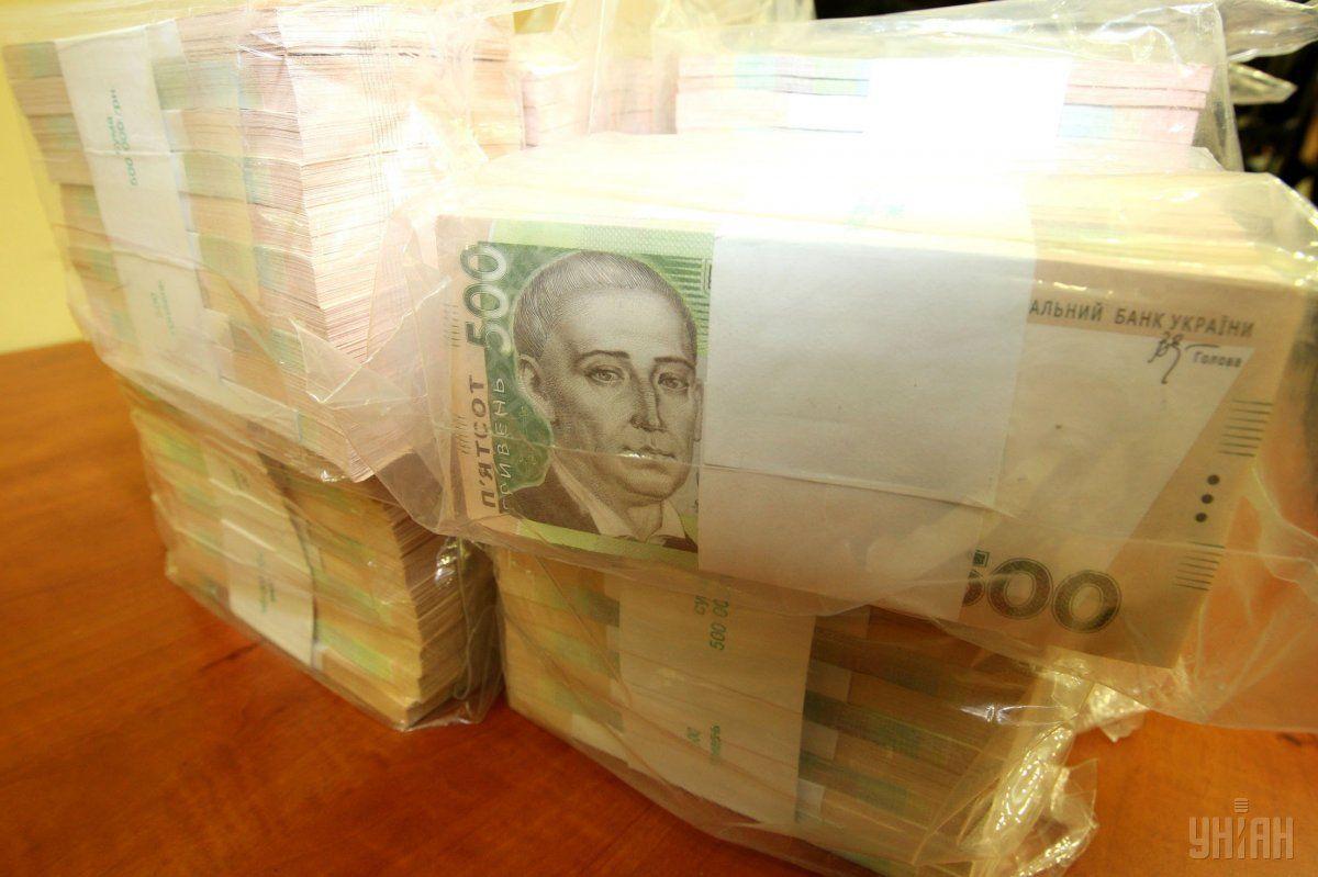 гривни гривны деньги взятка сковорода / Фото УНИАН