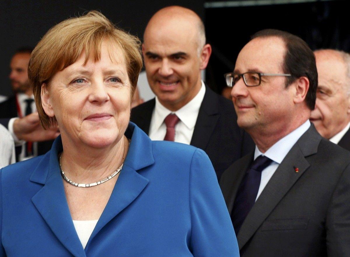 Ангела Меркель и Франсуа Олланд / REUTERS