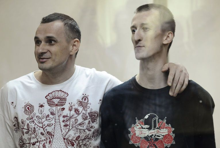 Sentsov (left) and Kolchenko (right) / REUTERS