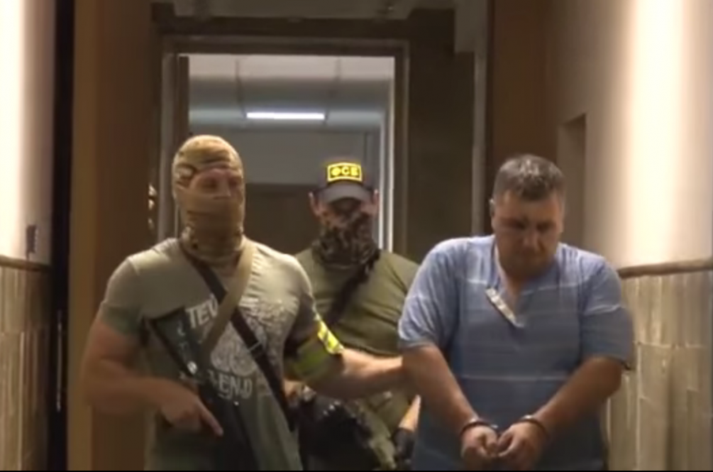 Panov amid detention / A screenshot from youtube.com