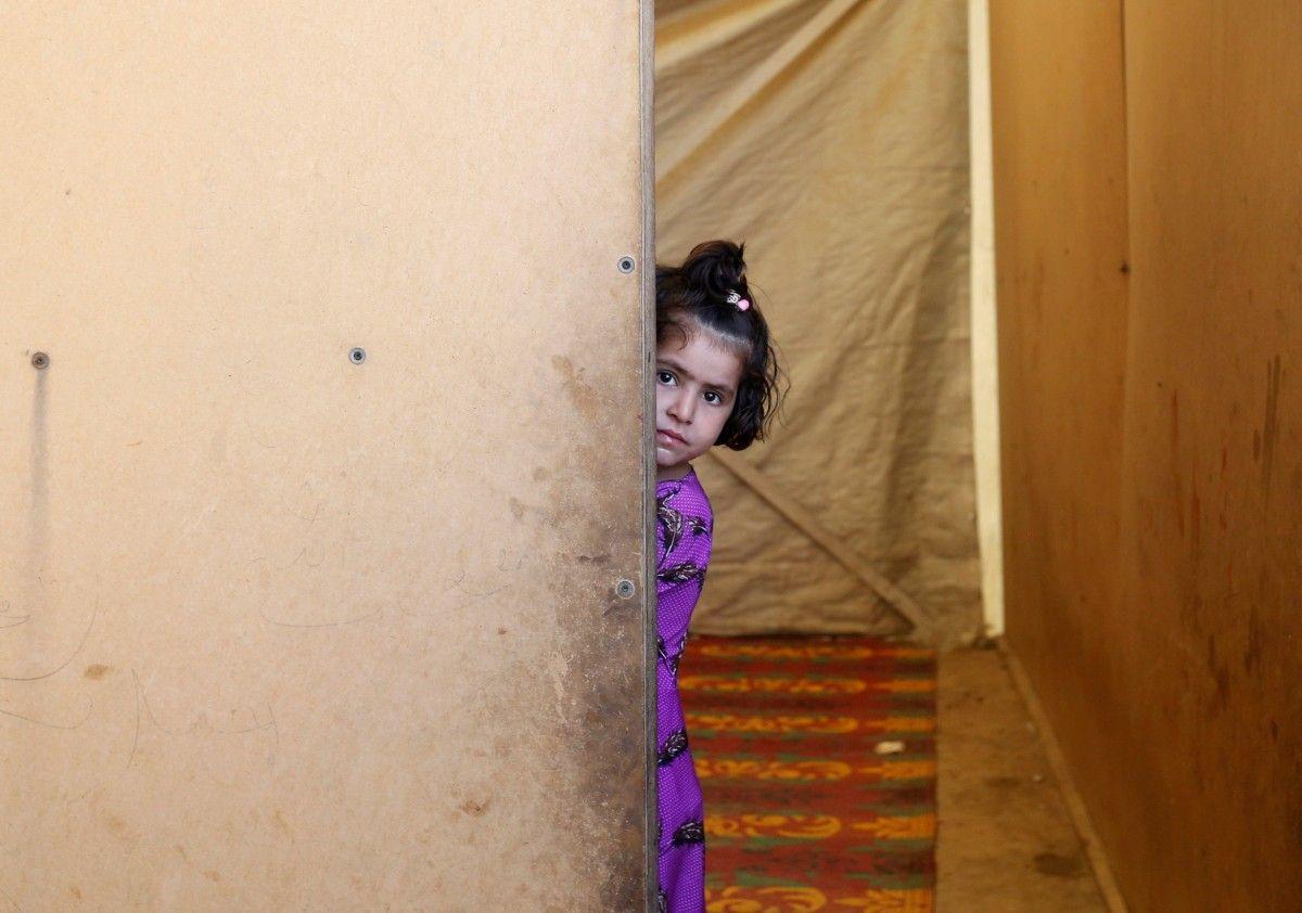 Почти пятая часть детей в развивающихся странах живут за чертой бедности / REUTERS