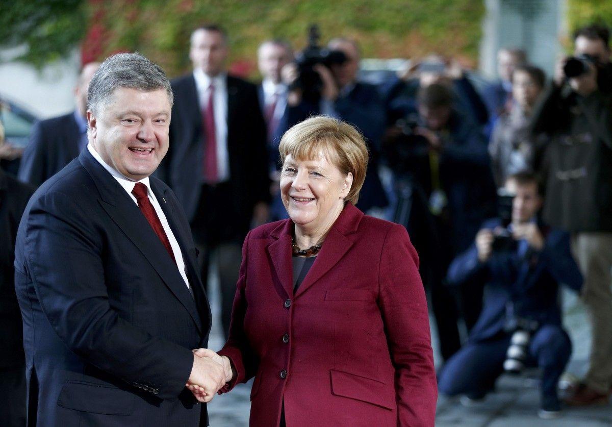 Петро Порошенко і Ангела меркель / їREUTERS
