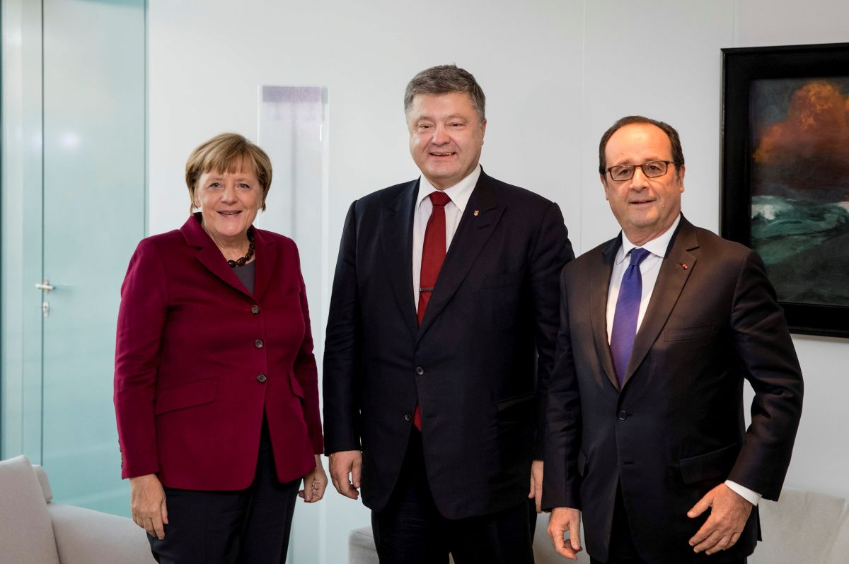 Ангела Меркель, Петро Порошенко та Франсуа Олланд / REUTERS