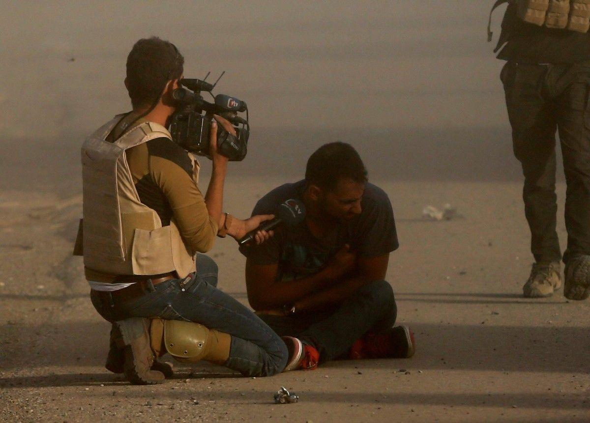 Репортер в Ираке / REUTERS