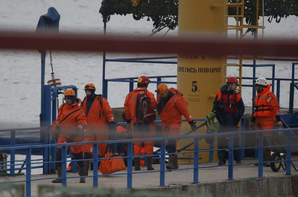 Операция на месте падения Ту-154 / REUTERS