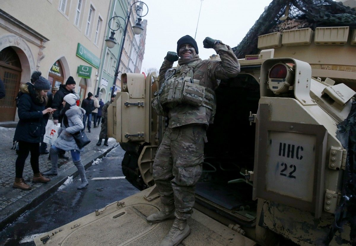 A NATO soldier in Poland / REUTERS