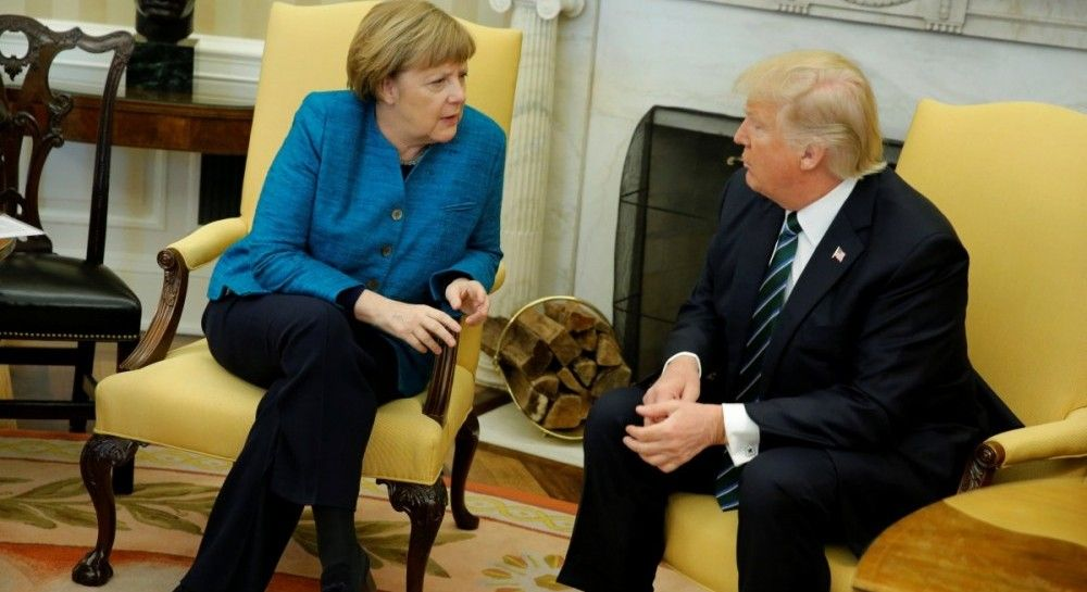 Trump, Merkel discuss need for peaceful solution of Donbas crisis